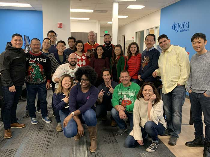 Agora team wearing ugly holiday sweaters